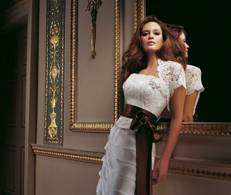 Butterfly & Pisa  A stunning combination for brides. Strapless scallop edged corset with satin ribbon sash and butterfly brooch and 10 tier satin faced organza A-line skirt.