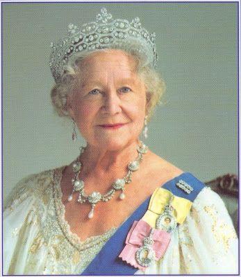 Queen Elizabeth the Queen Mother wears her Queen Elizabeth II Family Order and King George VI Family Order.