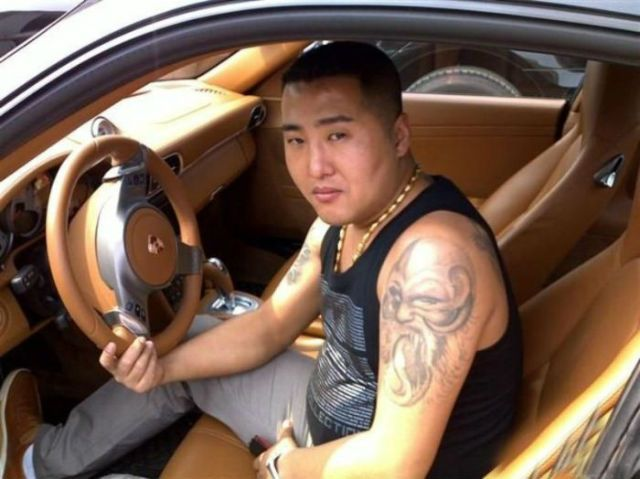 Pics found on the phone of chinese gangster feature porsches cash