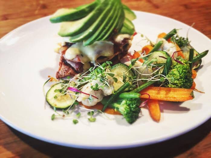 Chicken stack & Avo with chicken, bacon, avo and a thyme cheese sauce served with chips, veg or salad