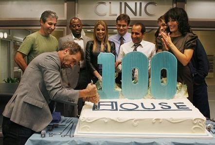 House 100 episode celebration: Hugh cuts the cake! With (l-r) David Shore, Omar Epps, Jennifer Morrison, Robert Sean Leonard, Taub whose name escapes me at the moment, Jesse Spenser, and Lisa Edelstein.