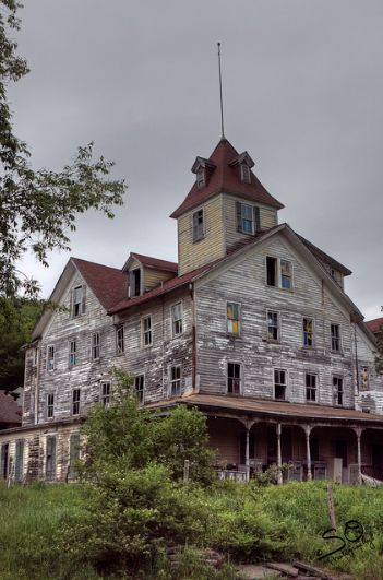 """The Cold Spring Hotel in Tannersville, New York. It was also known as """"Bieber's Cold Spring House"""". It has been abandoned for many years, it is now a draw for photographers and the curious."""