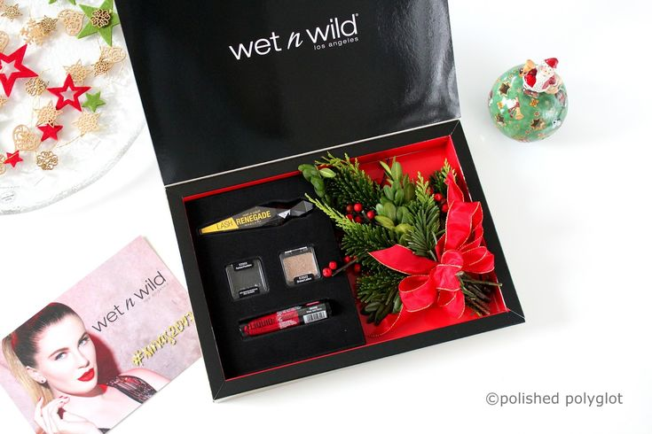 Classic makeup look with red lips and gold glitter for Christmas. Featuring Wetnwild makeup products.