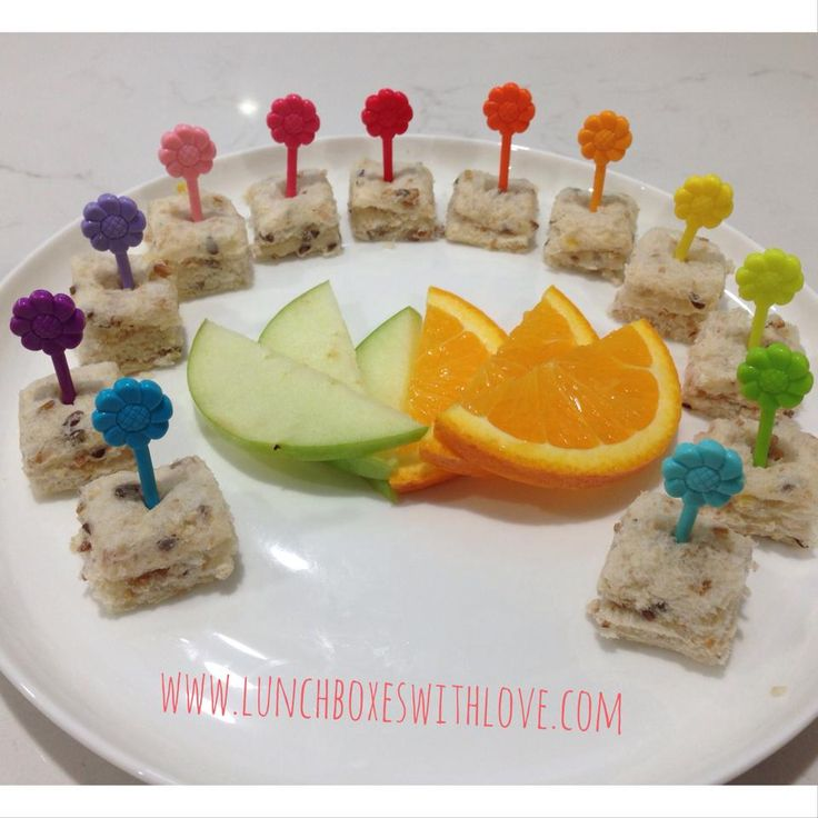 A sandwich cut into bite sized pieces using our Cube It! Cutter and then decorated using our Petal Food Picks www.lunchboxeswithlove.com