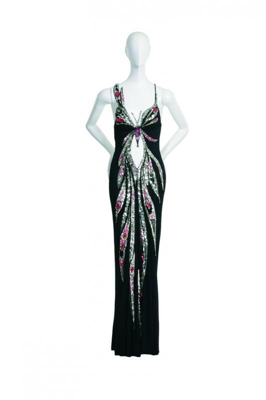 """BOB MACKIE BUTTERFLY MOTIF GOWN  Worn on the September 21, 1975 episode of """"The Cher Show"""" during the opening medley of """"Feeling Good"""" and """"I Feel The Earth Move.""""  Black alix jersey gown with embroidered butterfly in pink jewels"""