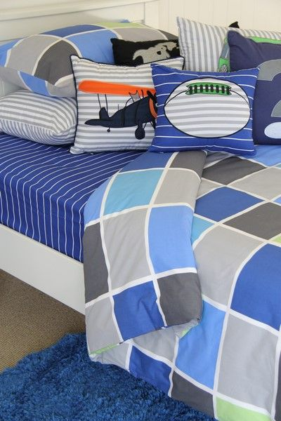 Blues & grey with a hint of orange & green is very rustic in a boys room. We love the Tom quilt cover with cotton cobalt sheeting & fun themed cushions. #patersonrose #boyslinen #boysrooms #boysbedroomdecor #cottonsheeting