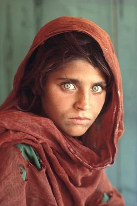 PAKISTAN. Peshawar. 1984. Afghan Girl at Nasir Bagh refugee camp. Steven McCurry. The first thing that attracted me to this famous image is the models unique eye colour, which is extremely striking. As this image is alot closer than many of the others, we can see the detail on her face/clothing, the girl has direct eye contact with the camera.