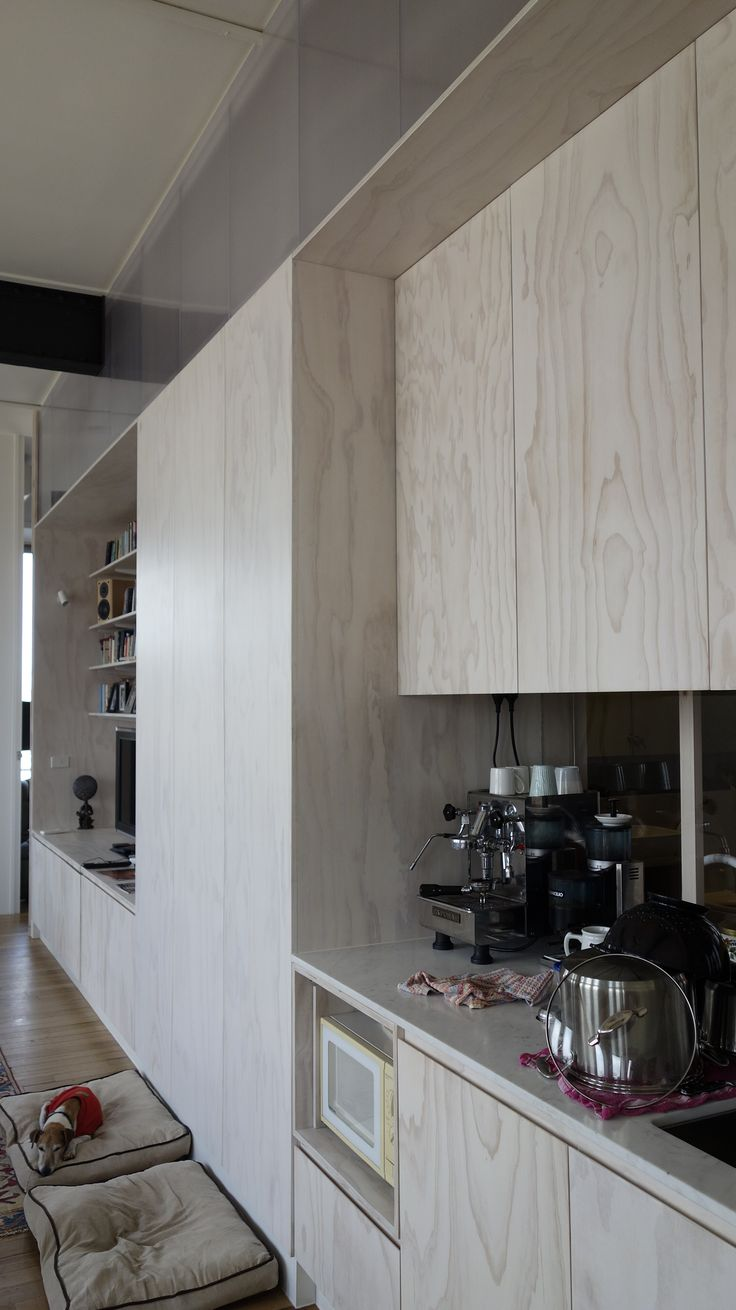 White washed plywood walls for kitchen bulkhead & stairs