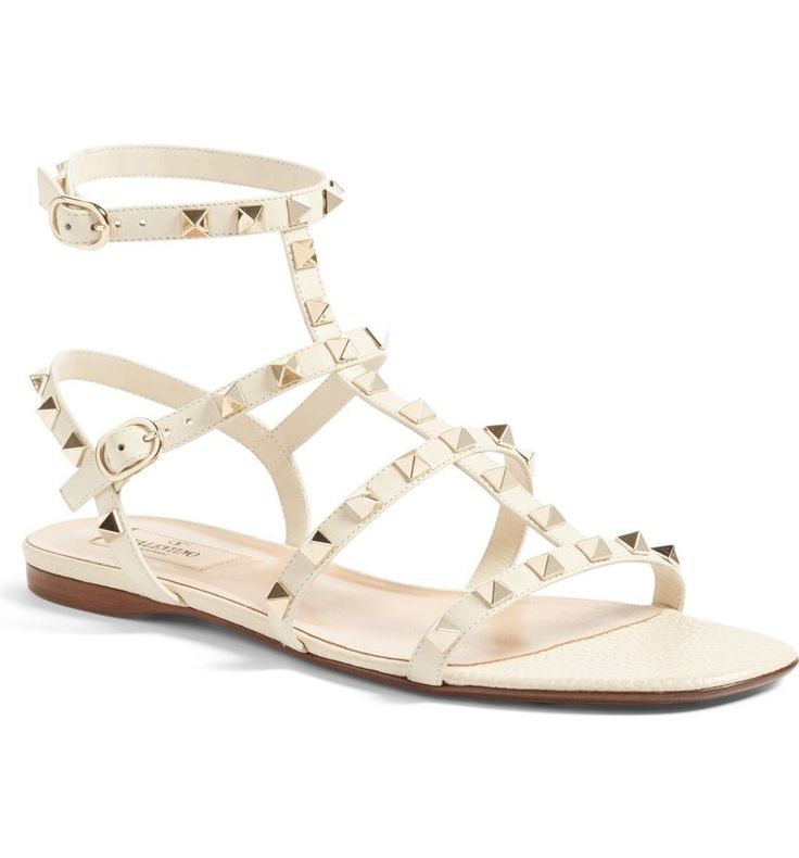 Regimented rows of pyramid studs punctuate the intersecting leather straps of this edgy gladiator sandal that will add a high-fashion touch to the everyday look.