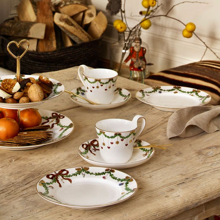 Beautiful cups, saucers and plates with red ribbons, Christmas fir and hanging tree decorations from #Royal #Copenhagen's #Christmas collection!