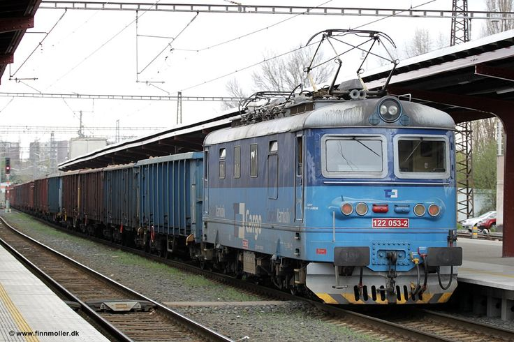 Czech Republic - CD Cargo 122 053 in Kolin at the back of a freight train headed by Cargo 122 022 on April 14, 2011