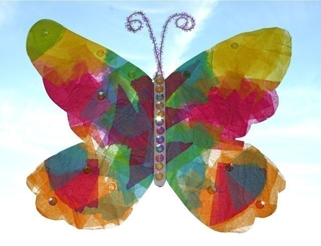 Beautiful butterfly!  Popsicle stick, jewel stickers, tissue paper, glitter pipe cleaners & contact paper!