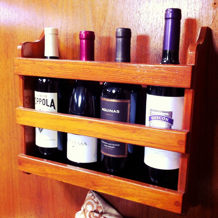 This magazine holder was mounted to our bulkhead and wasn't being used until voila! I realized it was perfect for doubling as a wine rack! #boat #sailboat #storage