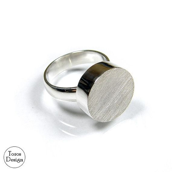 Modern circular ring. Handcrafted with sterling silver. Polished and partly matt.  This ring:  Circle diameter: 16 mm. Circle height