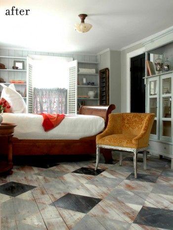 Distressed painted wood floors in checkerboard pattern.