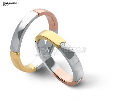 Fedi nuziali in oro giallo, bianco e rosa con pietra incastonata ...