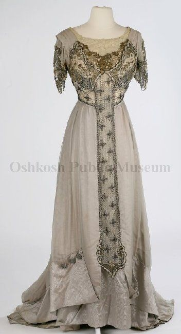 clean jewelry   tunic layered gray gown bodice neckline of off white embroidered lace and then gold lace both front and back bodice decorated with layers of gold silver and pearl beads and gold sequins