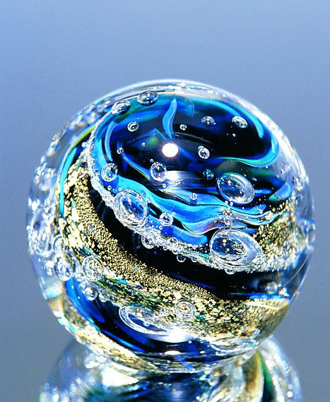 Blue Zoomie paperweight by Nourot. Cobalt and silver frits. Each unique. $95. USD