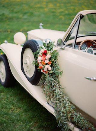 Vintage getaway car with flower garland | Kirill Bordon Photography | see more on: http://burnettsboards.com/2014/07/fiery-orange-1930s-wedding-inspiration-shoot/