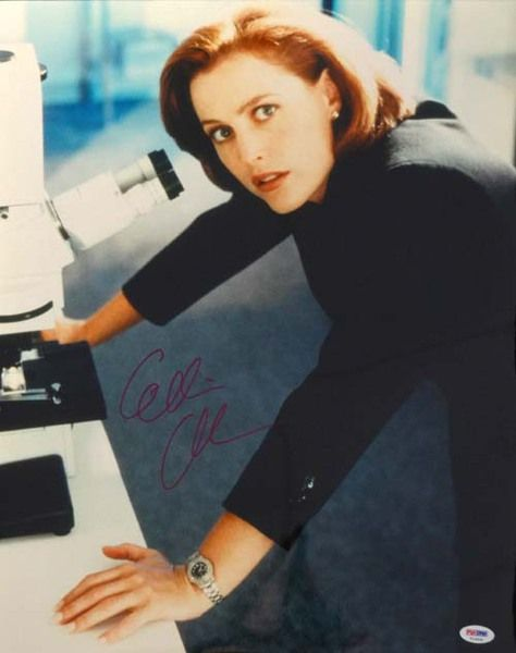 This is a 16x20 Photo that has been hand signed by Gillian Anderson. It has been authenticated by PSA/DNA and comes with their sticker and matching certificate of authenticity.