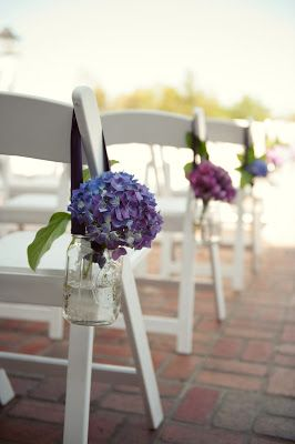 (1)Aisle: purple hydrangeas in mason jars hung from chairs- to be repurposed as centerpieces (surrounded by the baby green hydrangea in little bottles)