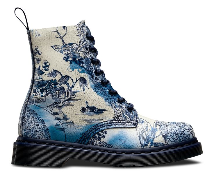 Our Willow Cristal Suede is based on an 18th Century English china plate design which in turn was inspired by Chinese ceramics. You won't need to treat these boots like china, their distressed top coat has been painted onto suede and designed to wear and crack over time, making each one as individual as you. A blue welt and blue sole make these truly unique.  Also Available in our 1461 Shoe