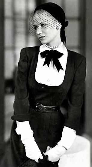 1940s Fashion <3 pearls, bows, sleeved detailing, black & white contrasting bodice....many tailoring details...trending multiple times over the last 4 decades..and now...
