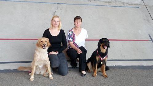 Alice Lee Coper from Black Meadow(gold) with her owner Monika Keřková  and Aim Elderberry(black and gold) from Black Meadow with her owner Pavlína Vajsová.