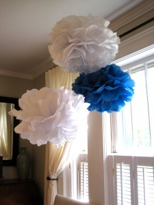 Nautical party pom poms made from ten pieces of tissue paper and pipe cleaner.
