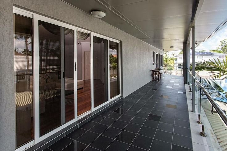 Prowler Proof ForceField Sliding Security Doors on a balcony on a luxury home in Sunnybank Hills. Stainless Steel Mesh allows the home owner to enjoy the view.