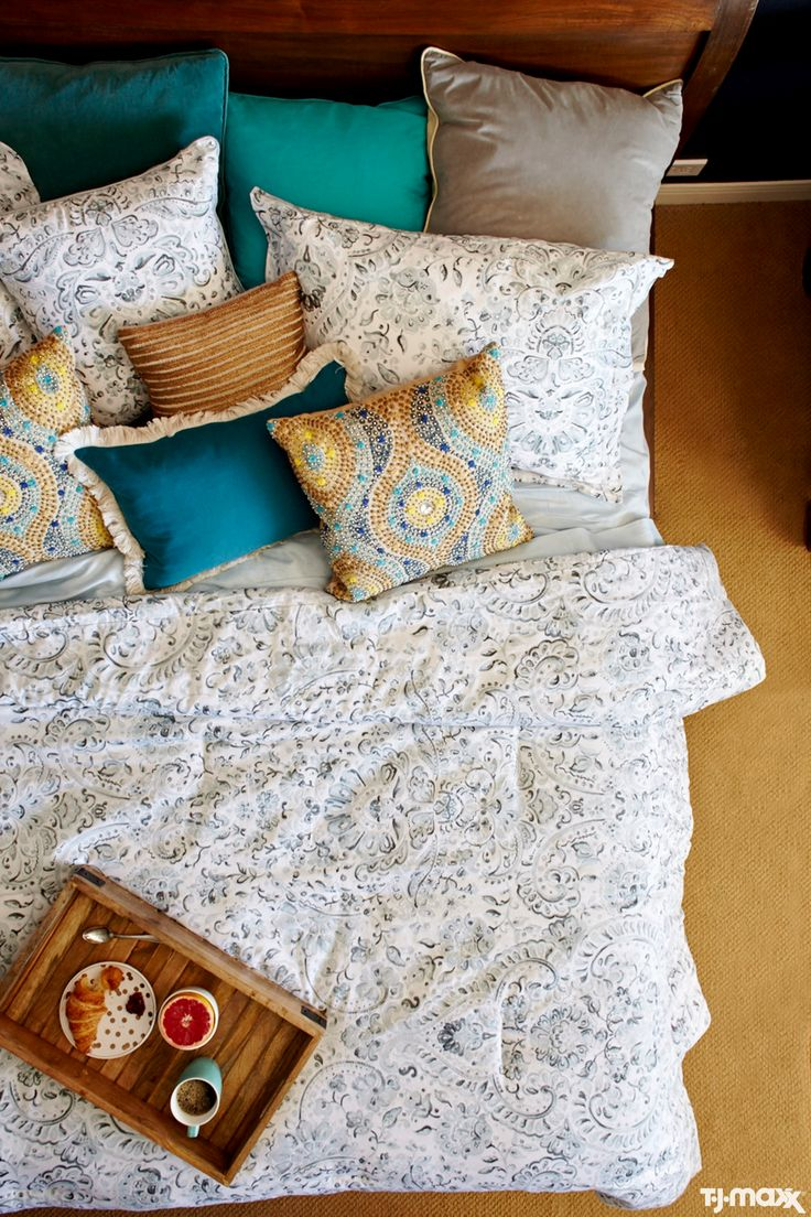 How to layer bedroom throw pillows: Start with two pillowcases that match your sheets, and two shams that match your comforter. Layer in a handful of simple, solid throw pillows you can use to prop yourself up. (Breakfast in bed, anyone?) Finish with statement pillows in bold patterns — these are all about style, so don't be afraid of intricate beading or textured trims.
