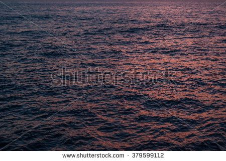 Abstract red and blue water ripples, waves at sunset light, suitable as texture, pattern, background.