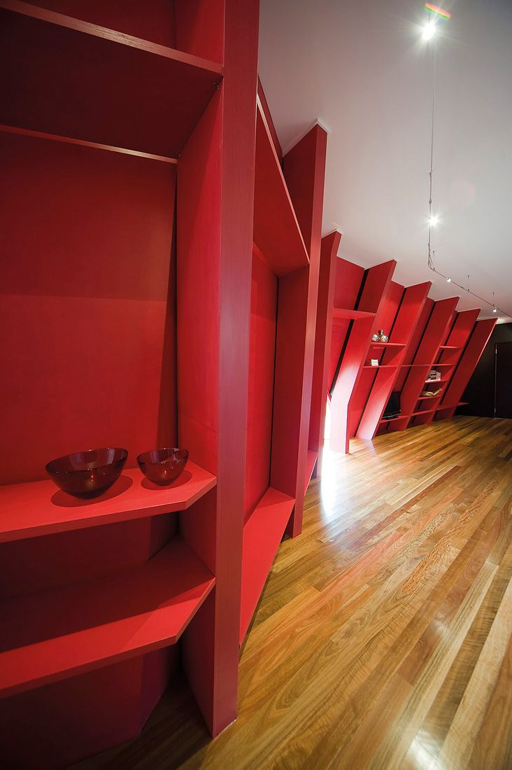 Red wall corridor with shelving and storage