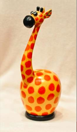 This adorable giraffe money bank is hand crafted in Bali and is not mass produced or factory made.