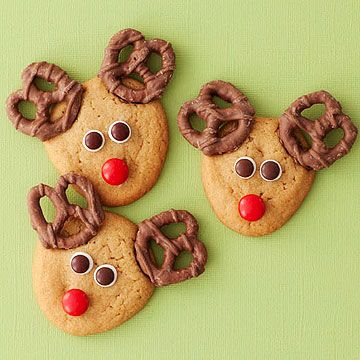 Turn peanut butter #cookies into red-nosed reindeer with the clever addition of chocolate covered pretzels and colored chocolate candies.
