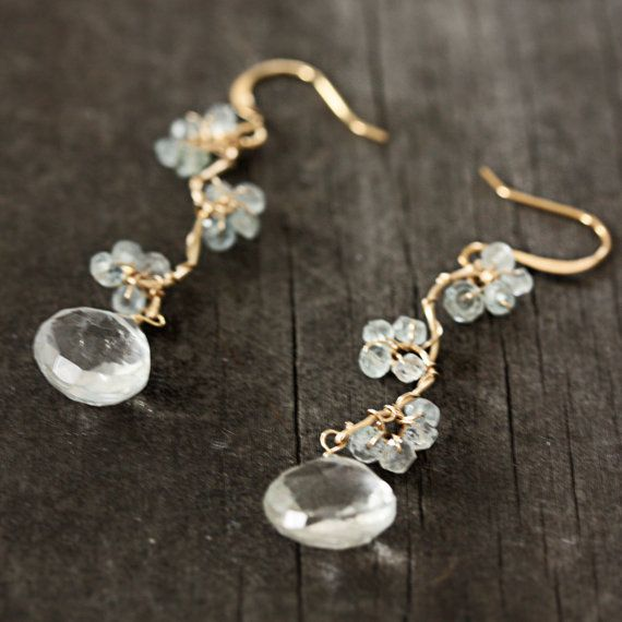 I used 14k gold fill wire to create this beautiful design and then hand wired tiny aquamarine roudels. I finished each with a tear drop shape,