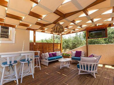 Rethymno villa rental - Great sitting area under the pergola, at the terrace!