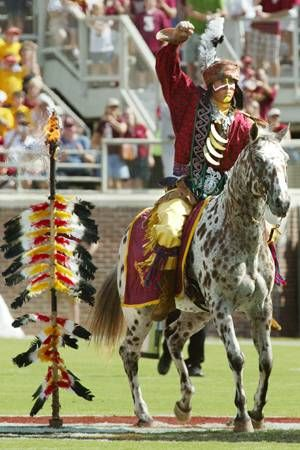 FSU - Florida State University Seminoles - Chief Osceola - Renegade - flaming spear at midfield