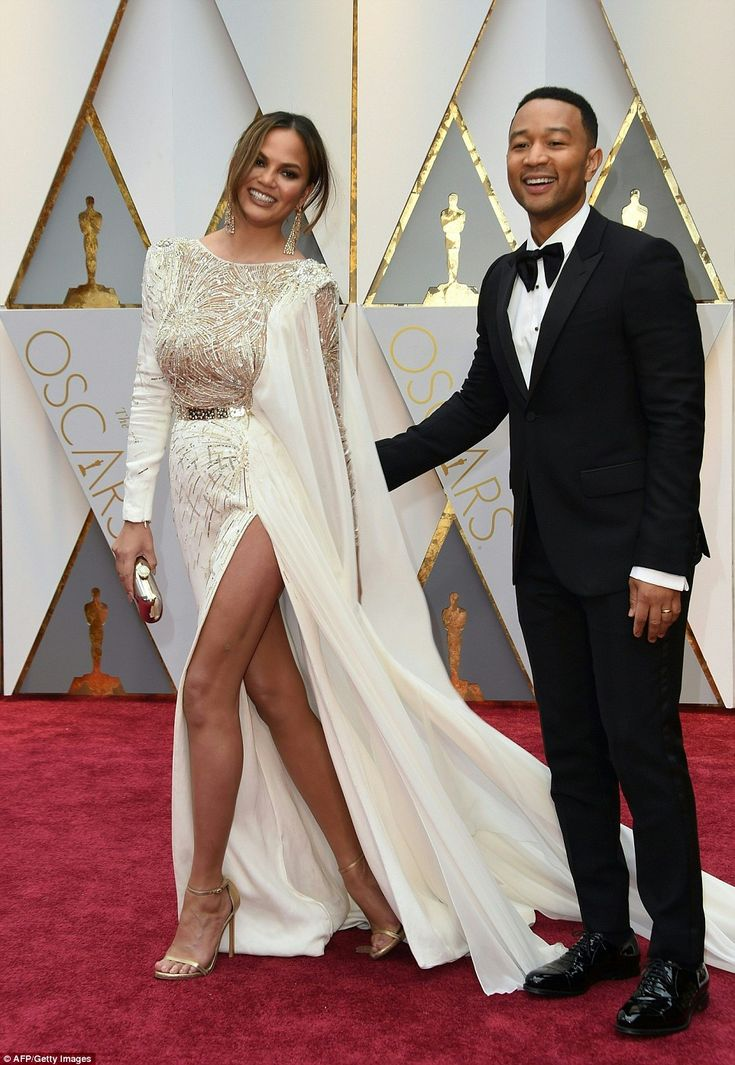 Couple goals: Model Chrissy Teigen and her actor husband John Legend, who appears in the movie of the night La La Land and will also be performing a piano medley on tonight's live show