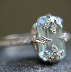 I love the leaf-like silver work of this ring. Looks exquisite over the aquamarine stone.