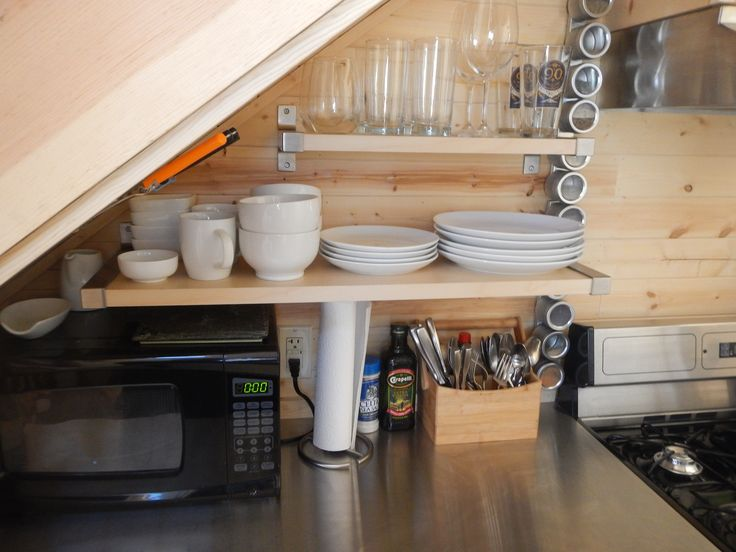 Make the most of the wall space in the kitchen. Shelves are from ikea. Magnetic spice tins. #tinyhome #tinyhouse #tinyhousekitchen #stainlesssteelcountertop #everythingineed