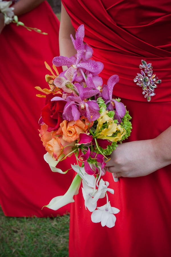 Bridesmaid bouquet with Orange Roses, Fuchsia Mokara Orchids, Yellow and Ruby Gloriosa Lilies, Red Roses, White Mini Calla, Baby Green Hydrangea, Orange Mokara Orchid, White Dendrobium Orchid