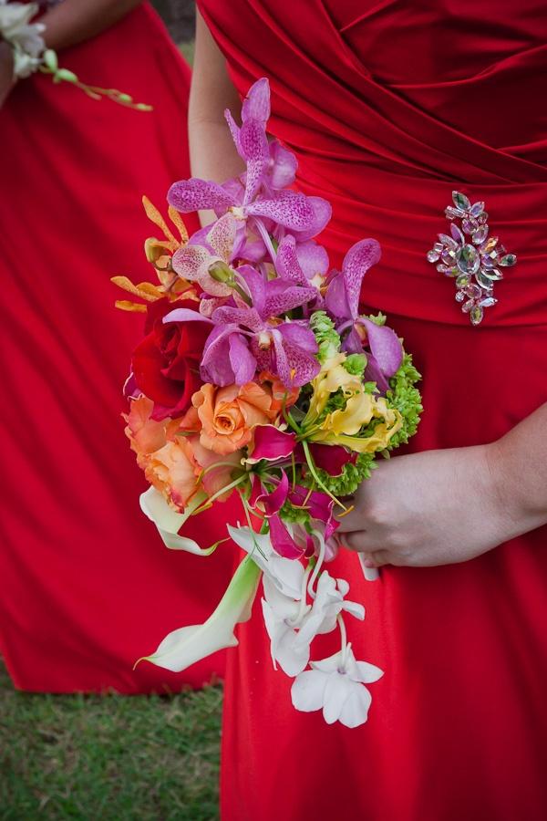 Bridesmaid bouquet with Orange Roses, Fuchsia Mokara Orchids, Yellow and Ruby Gloriosa Lilies, Red Roses, White Mini Calla, Baby Green Hydrangea, Orange Mokara Orchid, White Dendrobium Orchid