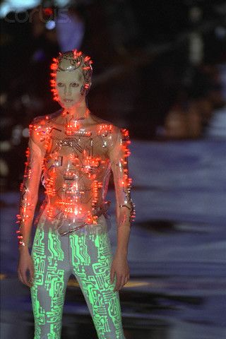 Tron-inspired suit with programmed multicolour flashing LEDs on transparent moulded body-suit by Kees van der Graaf for Alexander McQueen at Givenchy , ParisAutumn/Winter 1999.