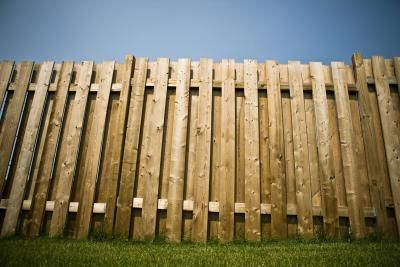 Pallet fence.  Doesn't have to be this tall.  Shoulder height would work too. How to Build a Pallet Fence | eHow.com