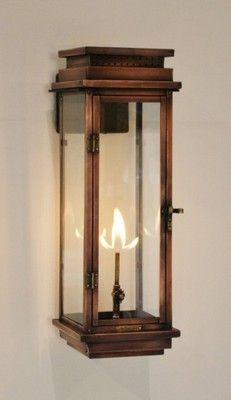 "The CopperSmith Contempo Gas Lantern, Contempo Lantern, this is also available with a solid back for a more ""flush"" mount appearance without the heat build up worry for a combustible surface.  www.gascopperlanterns.com or www.coppergaslanternsplus.com"