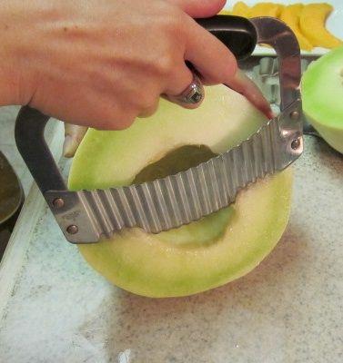 Edible arrangements. Cutting honeydew spears for fruit bouquet