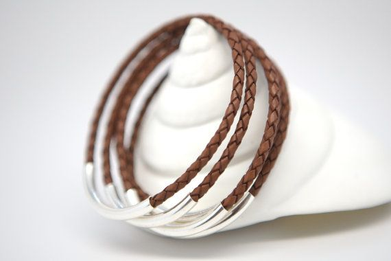I just love these bangles! They are simple and stylish and a cut above the rest - made of the highest quality materials, meant to last a lifetime. They are suitable for rugged 24/7 wear or everyday on-and-off. They are well designed and carefully crafted of braided round leather and thick sterling silver. A strong invisible jewelers glue holds them together beneath the tube in a waterproof environment - making them completely safe to keep on while washing hands - even dishes. They are…