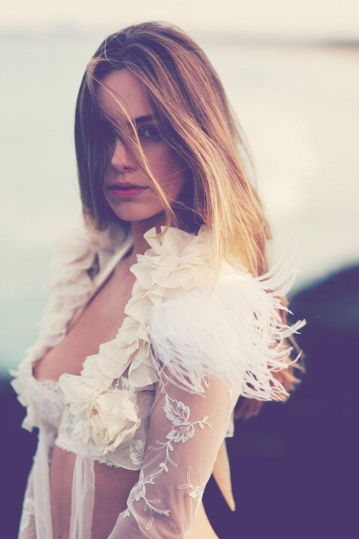 Stunning lace & feather wedding bolero. $280.00, via Etsy.