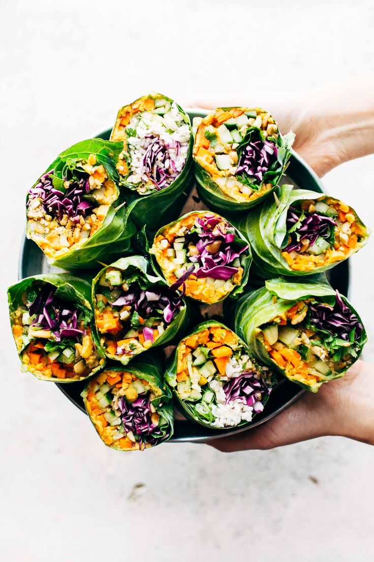 Detox Rainbow Roll-Ups - with curry hummus and veggies in a collard leaf, dunked in peanut sauce! most beautiful healthy desk lunch! | pinchofyum.com